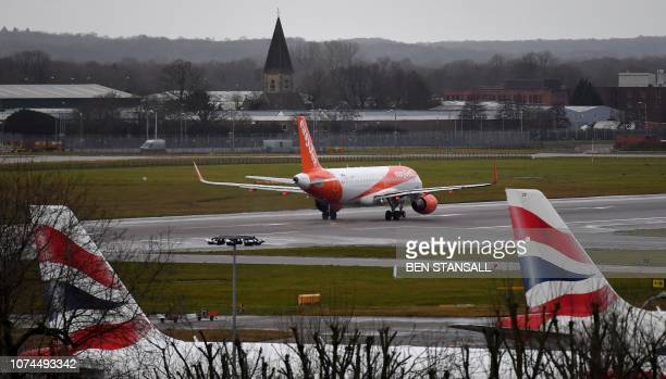An EasyJet aircraft prepares to take off from the runway at London Gatwick Airport south of London on December 21 as flights resumed following the...