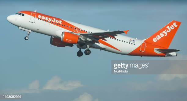 An EasyJet Europe Airline Airbus A320200 narrow body commercial airplane as seen on rotation and take off from Brussels Internation Airport Zaventem...
