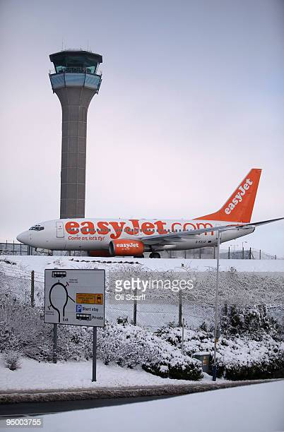 An Easyjet flight arrives at Luton airport on December 22 2009 in Luton England Adverse weather conditions of heavy snowfall have caused...