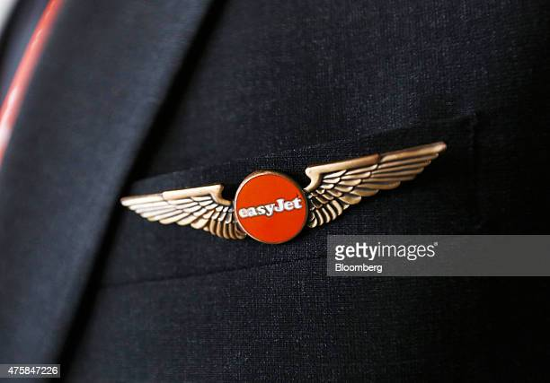 An Easyjet pin badge sits on a crew member's uniform as they attend the 'Easyjet Plc Innovation Event' held at Milan's Malpensa airport in Milan...