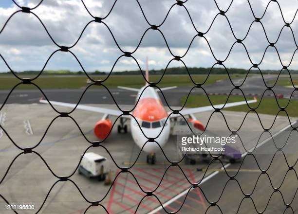 An EasyJet plane is seen at London Luton Airport as WizzAir resumes passenger flights on May 01 2020 in Luton United Kingdom British Prime Minister...