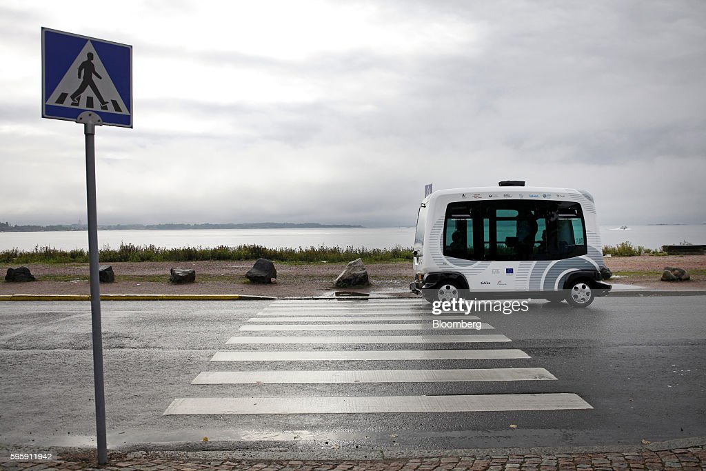 An EasyMile EZ-10 self-driving shuttle bus passes a pedestrian crossing on a public road during testing as part of the Sohjoa pilot project in Helsinki, Finland, on Friday, Aug. 26, 2016. While driverless trains for many years have served major international airports and some city routes, such as London's Docklands line, automated buses are still being tested. Photographer: Ville Mannikko/Bloomberg via Getty Images