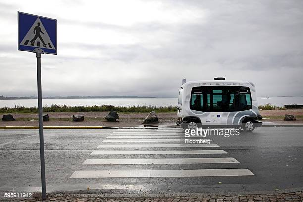 An EasyMile EZ10 selfdriving shuttle bus passes a pedestrian crossing on a public road during testing as part of the Sohjoa pilot project in Helsinki...