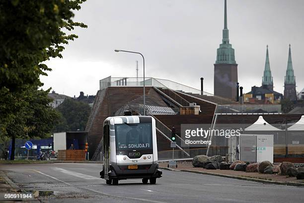 An EasyMile EZ10 selfdriving shuttle bus travels along a public road during testing as part of the Sohjoa pilot project in Helsinki Finland on Friday...