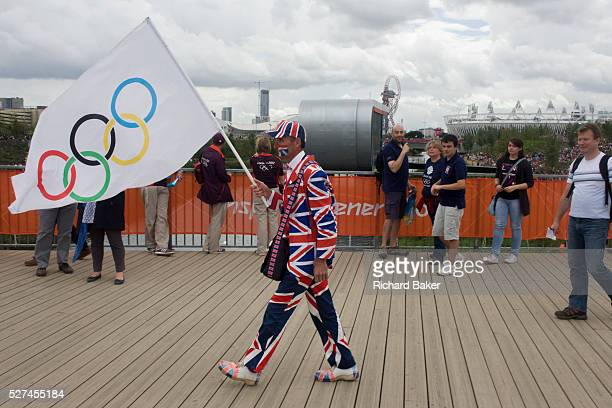 An eccentric Brit sports fan marches towards the Velodrome in the Olympic Park during the London 2012 Olympics. In the background is the main stadium...