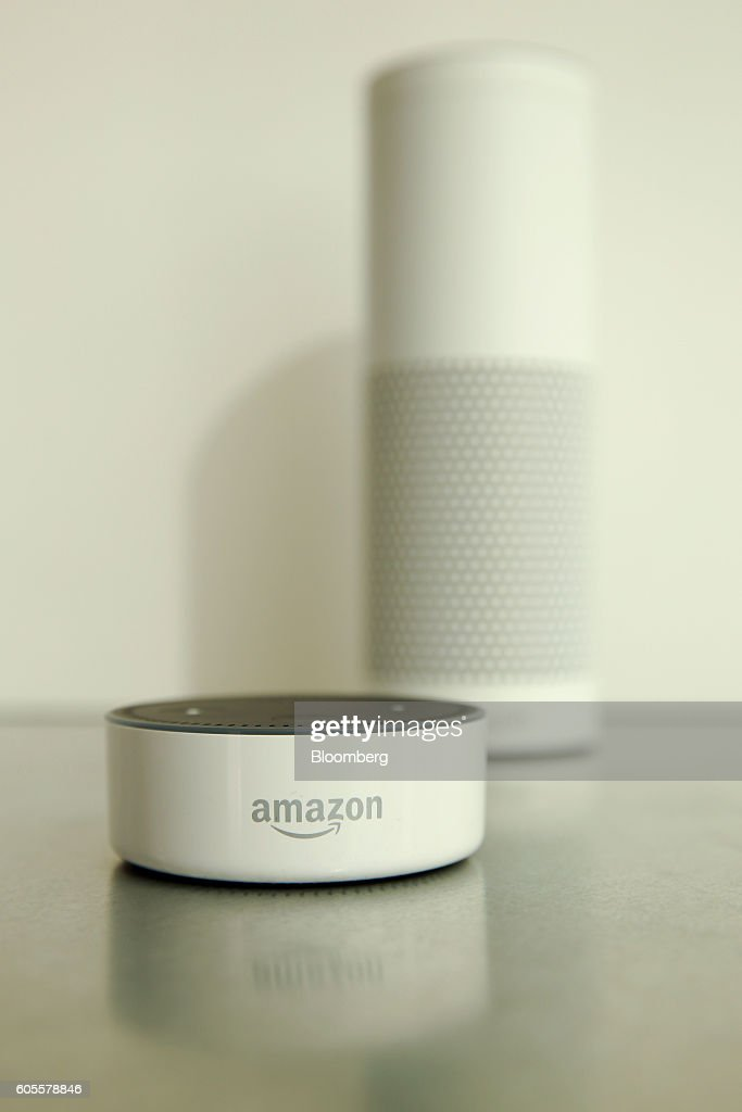 An 'Echo Dot' device, left, and an 'Echo' device stand on display during the U.K. launch event for the Amazon.com Inc. Echo voice-controlled home assistant speaker in London, U.K., on Wednesday, Sept. 14, 2016. The Seattle-based company today announced that its Echo product line will be available in the U.K. and Germany starting in the fall, the first time the gadget will be available outside the U.S. Photographer: Luke MacGregor/Bloomberg via Getty Images