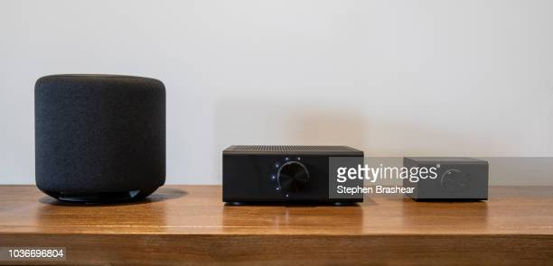 An 'Echo Sub' Echo Link Amp' and 'Echo Link' are pictured at Amazon Headquarters follow a launch event on September 20 2018 in Seattle Washington...
