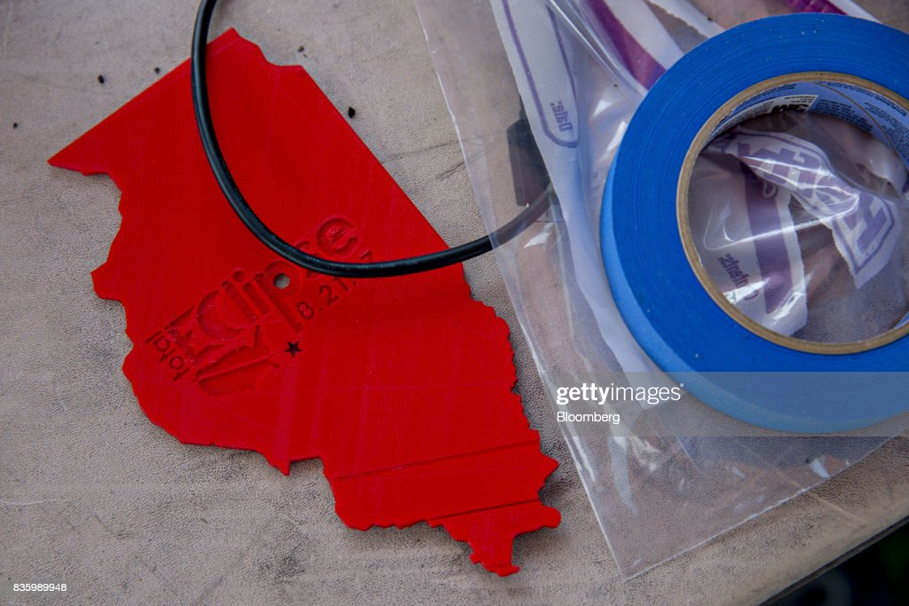 An eclipse souvenir sits on a table during an arts and crafts fair ahead of a total solar eclipse on the campus of Southern Illinois University (SIU) in Carbondale, Illinois, U.S., on Sunday, Aug. 20, 2017. Millions of Americans across a 70-mile-wide (113-kilometer) corridor from Oregon to South Carolinawill see the sky darken as the sun disappears from view, albeit for only a few minutes at a time. Photographer: Daniel Acker/Bloomberg via Getty Images