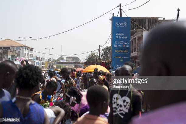 An Ecobank Guinea Bissau advertisement totem stands outside a bank branch at Bandim market in Bissau GuineaBissau on Monday Feb 12 2018 The...