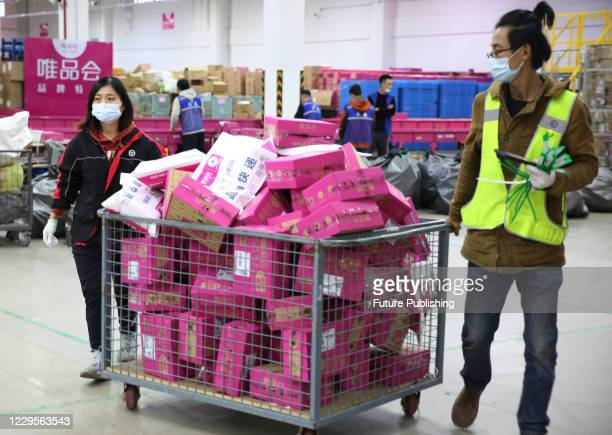 An e-commerce worker collects express mail at the Qingdao Cross-border E-commerce Industrial Park in Qingdao, Shandong Free Trade Zone, on November...
