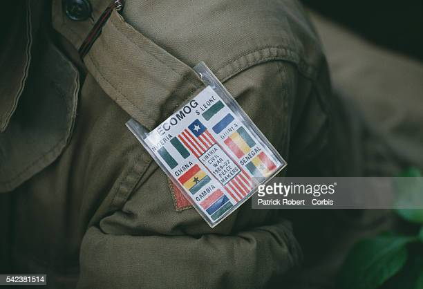 An ECOMOG soldier wears an arm band depicting other African conflicts with the mention LIBERIA CIVIL WAR 198992 PEACE MAKERS In 1989 Charles Taylor...