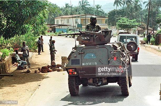 An ECOMOG soldiers driving an armoured car patrols 24 January on Wilkinson Road in Freetown A Nigerianled intervention force battling a rebel...