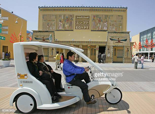 An ecotaxi passes in front of the Egyptian Pavilion at the 2005 world exposition in Nagakute Aichi Prefecture 06 April 2005 The Expo set up in a...