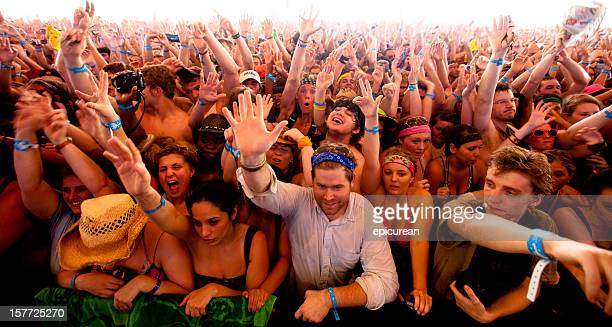 An ecstatic crowd of cheering fans at music festival