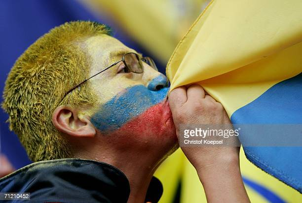 An Ecuador fan celebrates by kissing their flag after the final whistle at the FIFA World Cup Germany 2006 Group A match between Ecuador and Costa...