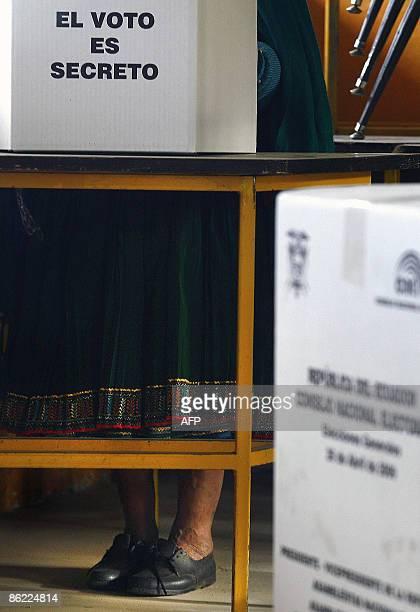 An Ecuadorean native casts her ballot at a polling station in Cangahua Ecuador during general elections on April 26 2009 Ecuador's President Rafael...