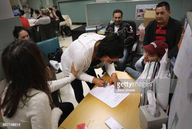 An Ecuadorian immigrant signs a legal document giving custody of her children to friends in case she and her husband are deported on March 25 2017 in...