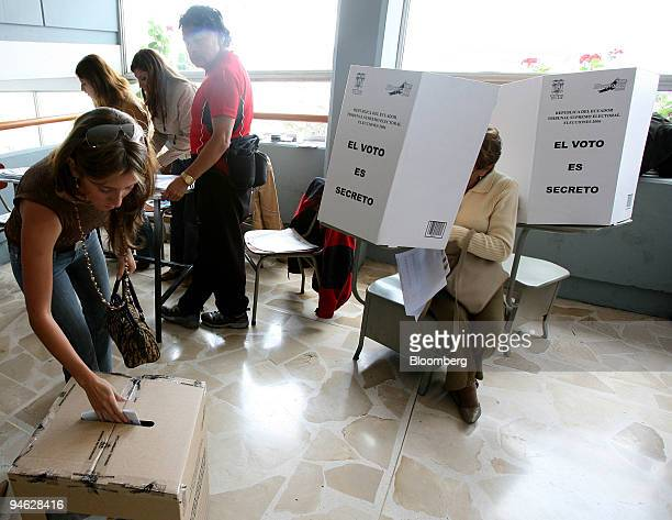 An Ecuadorian woman votes at a polling station on election day in Quito Ecuador on Sunday October 2006 Ecuador's largest banana exporter Alvaro Noboa...