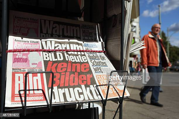 An edition of the Bild newspaper printed without any pictures is seen outside of a shop on the paper's publication day September 8 in Berlin Germany...