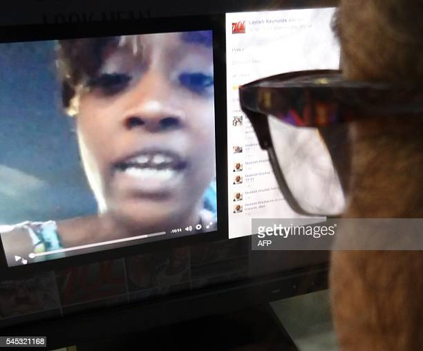 An editor watches a video on July 7 2016 in Washington DC showing the dying moments of a black man man shot by Minnesota police after being pulled...