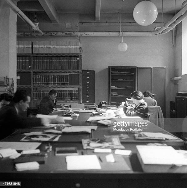 An editorial staff working in the office 1950s