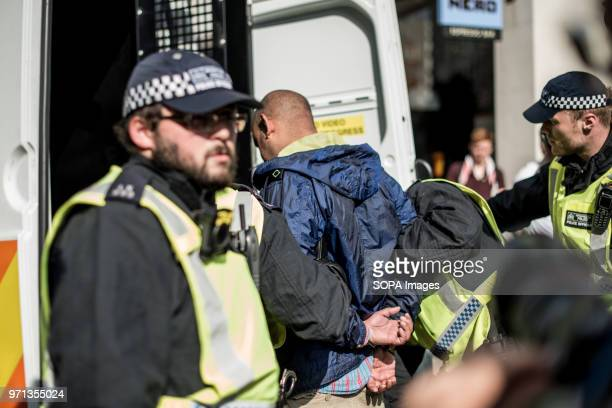 An EDL supporter arrested by police and putting in the police van Hundreds of antiIsrael protesters marched through the streets on the annual Al Quds...