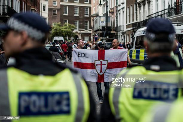 An EDL supporter seen holding an EDL flag in the counterdemo Hundreds of antiIsrael protesters marched through the streets on the annual Al Quds Day...