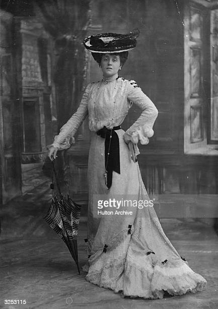 An Edwardian lady poses with a parasol.