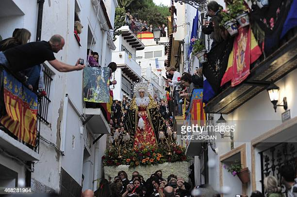 """An effigy of a Christian icon is carried by members of the """" La Dolorosa brotherhood during a Holy Week procession on April 1, 2015 in Alicante...."""