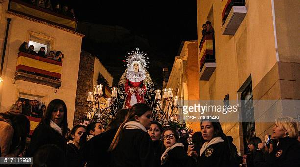 An effigy of a Christian icon is carried by members of the La Dolorosa brotherhood during a Holy Week procession on March 23 2016 in Alicante...