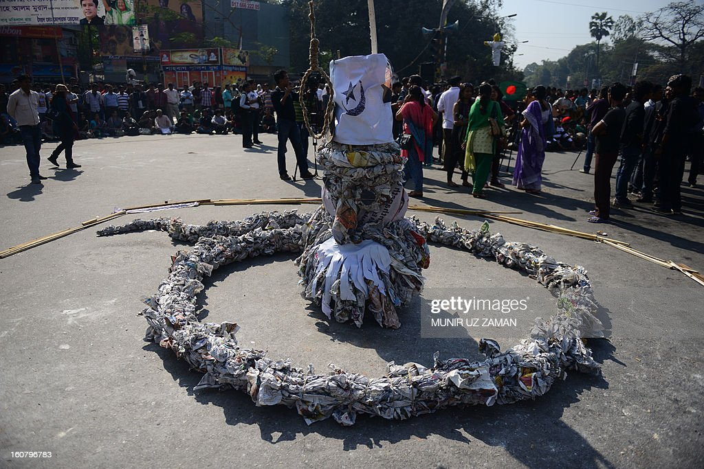 An effigy of a snake is pictured as Bangladeshi social activists and bloggers participate in a demonstration demanding the death sentence for the country's war criminals during a nationwide strike in Dhaka on February 6, 2013. Police fired rubber bullets Wednesday at hundreds of activists from Bangladesh's largest Islamic party during a second day of rioting sparked by the conviction of a top opposition figure for war crimes. AFP PHOTO/ Munir uz ZAMAN
