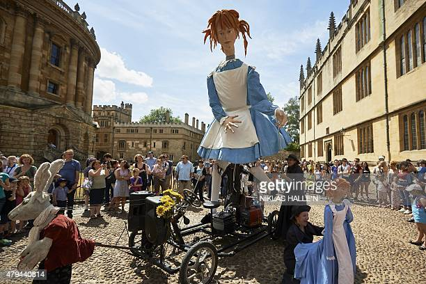 An effigy of Alice is paraded at The Story Museum in Oxford central England on July 4 during an event marking the 150th anniversary of the...