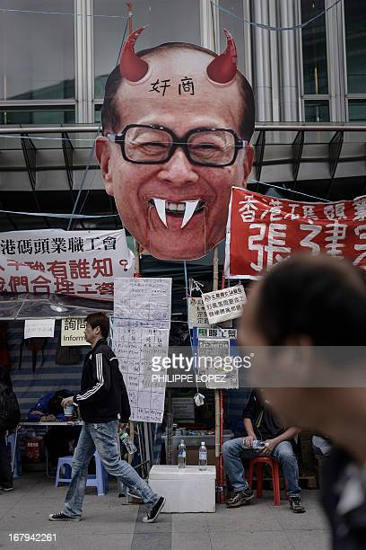 An effigy of Asia's richest man Li Kashing set up by dockers is displayed outside the Cheung Kong Center in Hong Kong on May 3 2013 About 450 dock...