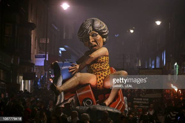 An effigy of Britain's Prime Minister Theresa May paraded through the streets of Lewes in East Sussex southern England on November 5 during the...