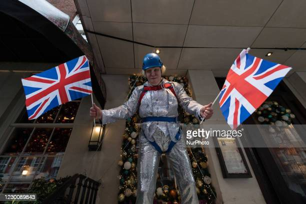 An effigy of British Prime Minister Boris Johnson in a sparkly festive suit, waving British flags is displayed outside 34 Restaurant in Mayfair, on...