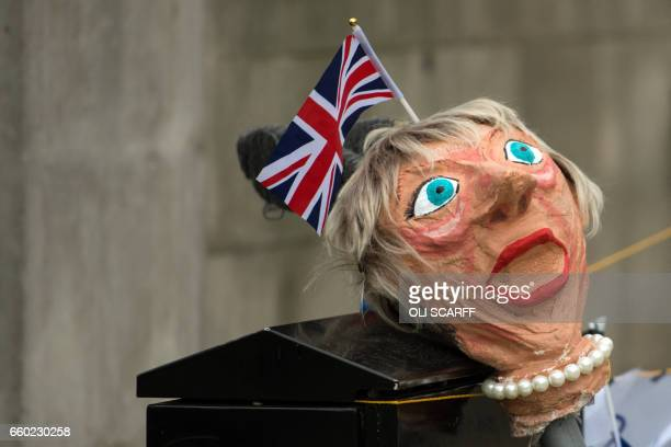 An effigy of British Prime Minister Theresa May is seen before being used by antiBrexit protesters in a demonstration on Whitehall opposite Downing...