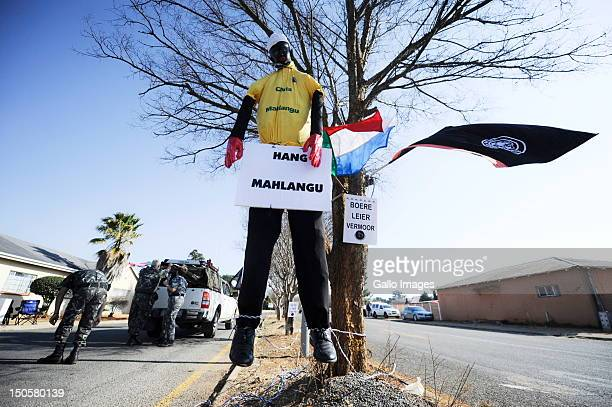 An effigy of Chris Mahlangu hangs outside the courtroom as he and his coaccused Patrick Ndlovu appear in court for sentencing outside in connection...