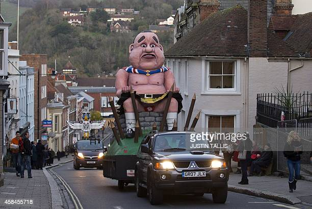 An effigy of defeated Scottish independence leader Alex Salmond is paraded through Lewes Sussex on November 5 before it gets burnt in the traditional...