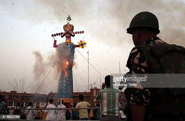 An effigy of demon King Ravana goes up in flames marking the end of Dussehra festival on October 11 2016 in Jammu India Ramleela is a dramatic folk...