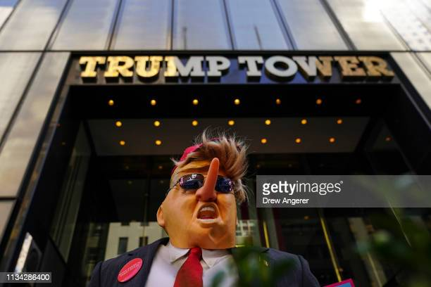 An effigy of Donald Trump stands outside of Trump Tower during an April Fools' Day protest against US President Donald Trump April 1 2019 in New York...