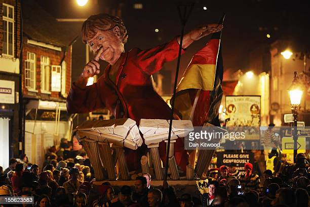 An effigy of German Chancellor Angela Merkel is paraded as bonfire societies process through the streets during the Bonfire Night celebrations on...