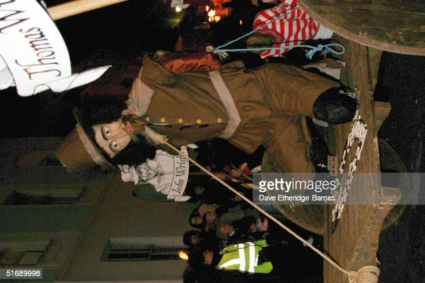 An effigy of Guy Fawkes is paraded during the Bonfire Night celebrations on November 5 2004 in Lewes Sussex in England Bonfire Night is related to...