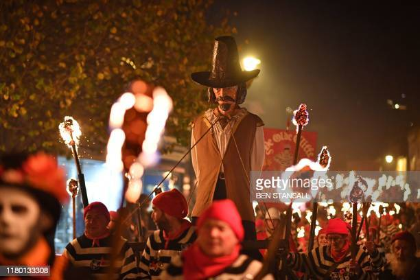 An effigy of Guy Fawkes is paraded through the streets of Lewes in East Sussex, southern England, on November 5 during the traditional Bonfire Night...