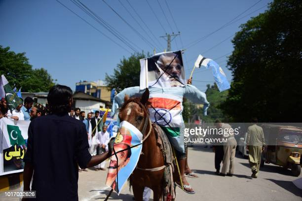An effigy of Indian Prime Minister Narendra Modi places on a horse is pictured during an antiIndian protest in Muzaffarabad capital of...