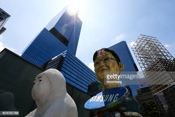 An effigy of Jay Y Lee covice chairman of Samsung Electronics Co stands outside the Samsung Seocho office building in Seoul South Korea on Tuesday...