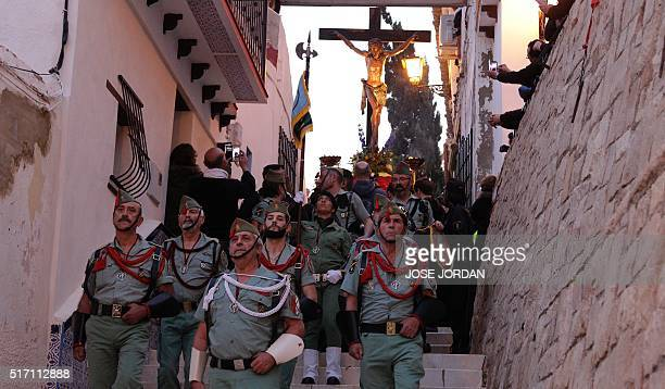 An effigy of Jesus Christ on the cross is carried during the Cristo de la Fe populary known as the gypsy Christ parade during a Holy Week procession...