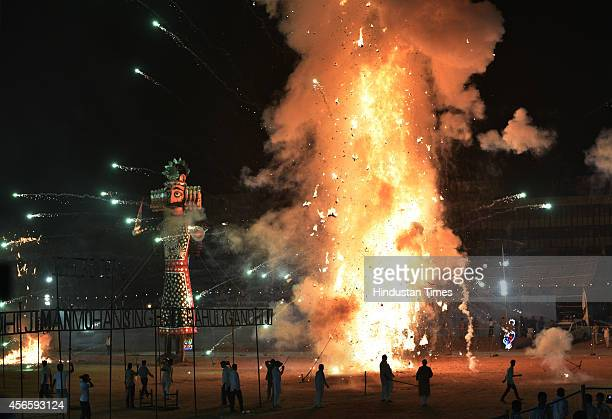 An effigy of Kumbhkaran goes up in flames as the effigy of the Hindu demon king Ravana next in turn to be burnt during Dussehra celebrations at...