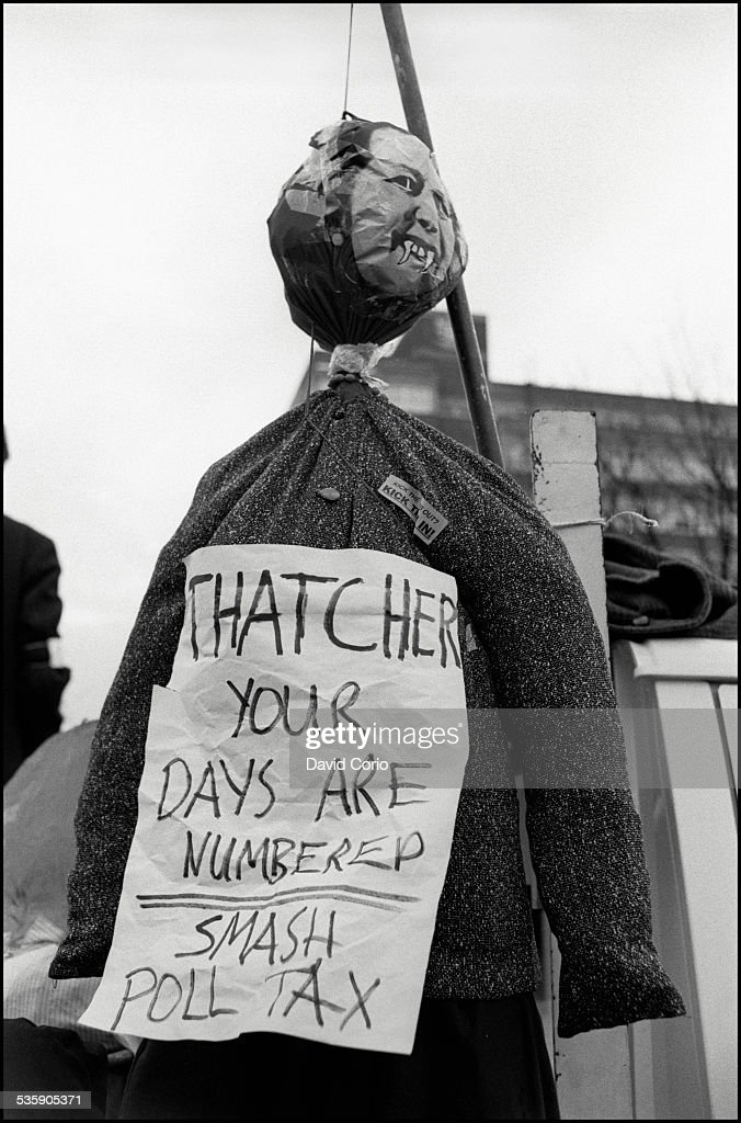 An effigy of Margaret Thatcher at a Poll Tax demonstration on Market Road, London, N7 , UK, 5th November 1989. The sign reads 'Thatcher your days are numbered. Smash poll tax.'