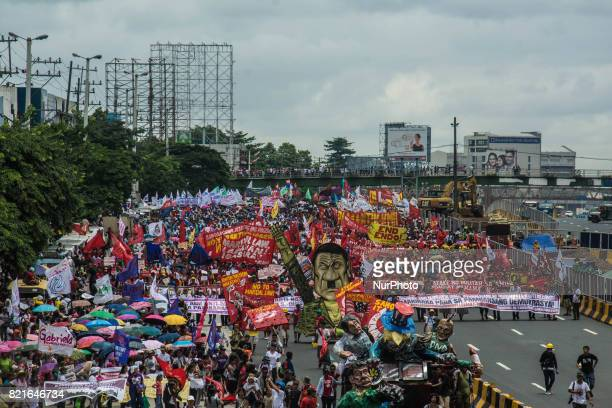 An effigy of President Rodrigo Duterte with a mustache that resemble like that of Hitlers is seen among the crowd of protesters marching towards...