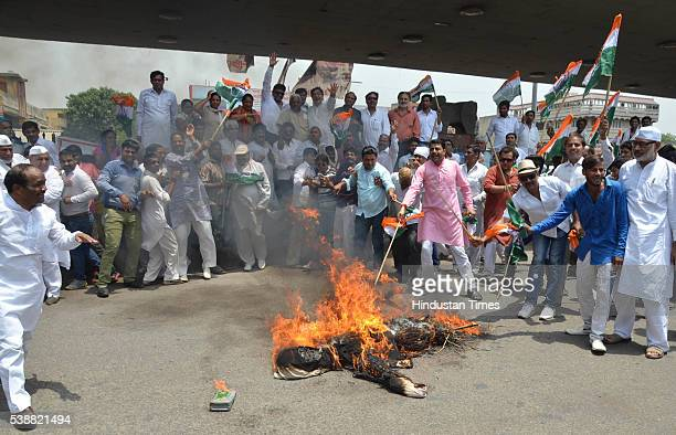 An effigy of Prime Minister Narendra Modi being burned by Congress workers during protest against Central Government over the issue of price rise on...
